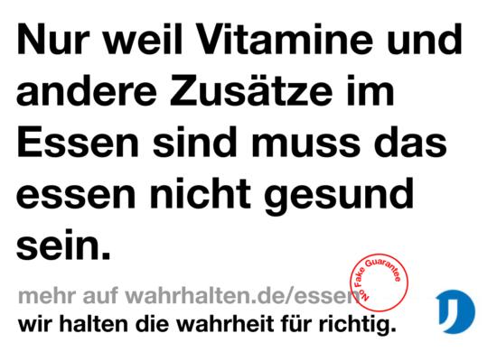 """Slogan """"Nur weil Vitamine und andere Zusätze im Essen sind, muss das Essen nicht gesund sein."""""""